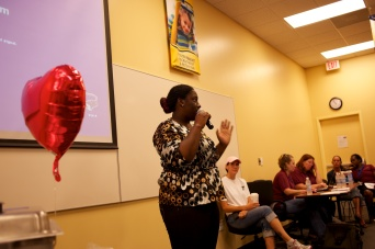 Maria speaks to a packed house of foster parents at Hillsborough Kids, Inc.